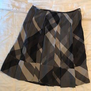 Gorgeous Burberry 100% silk skirt. Below knee NWOT